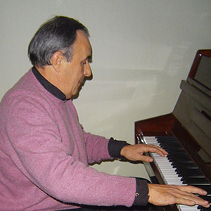 Alan Waldie playing the piano